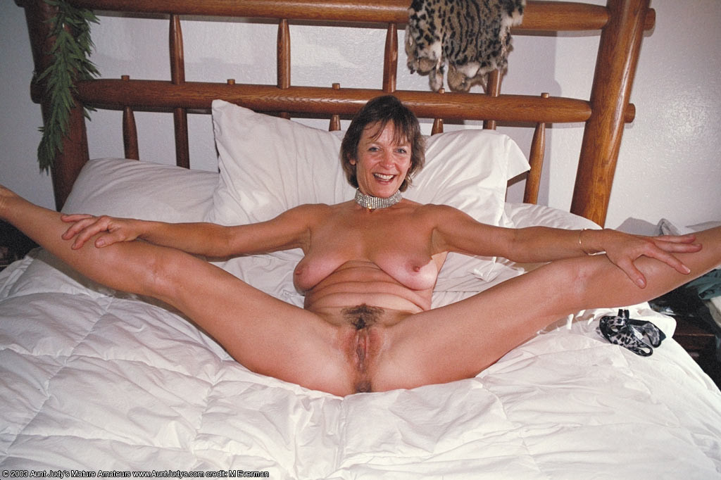 in bed mature nude
